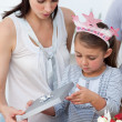 Little girl opening Birthday gifts — Stock Photo