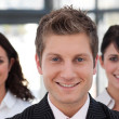 Joyful business team looking at the camera — Stock Photo #10822060