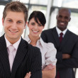 Cheerful business team looking at the camera — Stock Photo