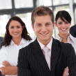 Young business team looking at the camera - Stock Photo