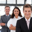 Smiling business team looking at the camera — Stock Photo