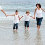 Cute Family on the beach having fun — Stock Photo #10822259