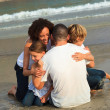 Young Family on the beach having fun — Stock Photo