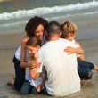 Young Family on the beach having fun — Stock Photo #10822267