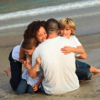 Joyful Family on the beach having fun — Stock Photo #10822306