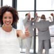 Successful Businesswoman doing a thum-up with his colleagues — Stock Photo