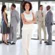 Cute Businesswoman arms folded with his colleagues — Stock Photo