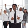 Joyful male manager doing a thumb-up with his team — Stock Photo