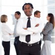 African male manager standing at the camera with his team — Stock Photo