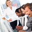 Blond female manager leading her representative team — Stock Photo #10822619