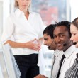 Radiant manager leading her representative team — Stock Photo