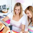 Stock Photo: Two Caucasiwomen are doing shopping