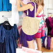 Stock Photo: Two radiant women selecting item