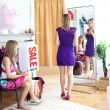 Cute women choosing clothes together — Stock Photo #10823386