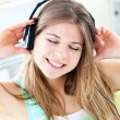 Jolly woman listen to musik — Stock Photo