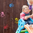 Little girl and her mother having fun with a chute — Stock Photo #10823491
