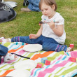 Stock Photo: Little girl having a picnic