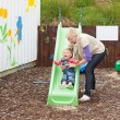 Young girl and her mother having fun with a chute — Stock Photo #10823644