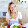 Positive young womeating salad — Stock Photo #10823672
