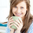 Positive attractive businesswoman holding a cup — Stock Photo