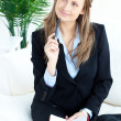 Thoughtful businesswoman taking notes — Stock Photo