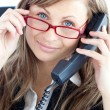 Attractive business woman on phone wearing red glasses — Stock Photo