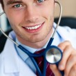 Glowing doctor holding a stethoscope — Stock Photo #10824186