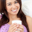 Beautiful woman holding a cup of coffee — Stock Photo