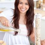 Jolly woman prepare a salad smiling at the camera — Stock Photo #10824306