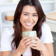 Handsome woman drinking coffee in the kitchen — Stock Photo #10824308