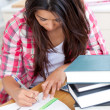Stock Photo: Young womdoing her homework