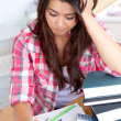 Stressed student doing her homework — Stock Photo