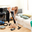 Portrait of a bored woman vacuuming — Stock Photo #10824327