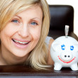 Laughing woman with a piggy bank — Stock Photo