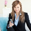 Serious attractive businesswoman using her mobile phone — Stock Photo #10824455