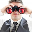 Smiling businessman using binoculars — Stock Photo