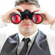 Stock Photo: Smiling businessman using binoculars