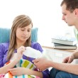 Young man with tissues and his sick girlfriend — Stock Photo #10824612