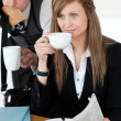 Stock Photo: Beautiful businesswomand drinking coffee while her husband hurr