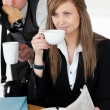 Beautiful businesswomand drinking coffee while her husband hurr — Stock Photo #10824686