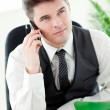 Smiling young businessman talking on phone — Stock Photo
