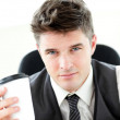 Royalty-Free Stock Photo: Serious businessman drinking coffee in the office