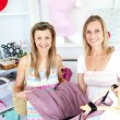 Two cute women choosing clothes together — Stock Photo