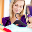 Bright woman is doing shopping — Stock Photo