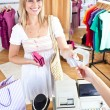 Stock Photo: Caucasiwomis paying items