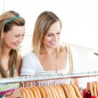 Two radiant women doing shopping - Stock Photo