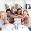 Smiling teenagers studying Science in a library — Stock Photo