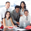 Foto Stock: Multi-ethnic business team working together in office