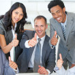 Stock Photo: Business team with thumbs up in office