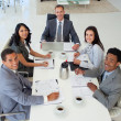 Business in a meeting smiling at the camera — Stock Photo #10825038